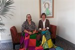 Suzi Rowe and Ros Edwards sitting with knitted blankets on their legs for the presentation.jpg