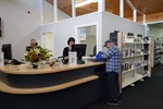 Cathy and Amanda serving a man on Opening day at the newly refurbished Gloucester Library.jpg