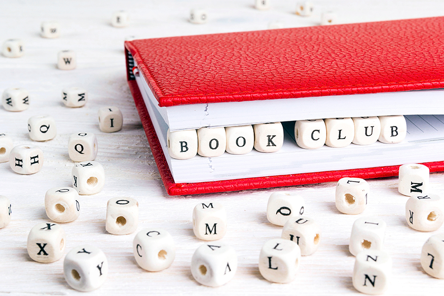 Book with bookclub spelt out in beads