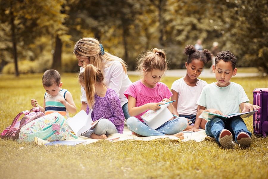 Kids reading in a park